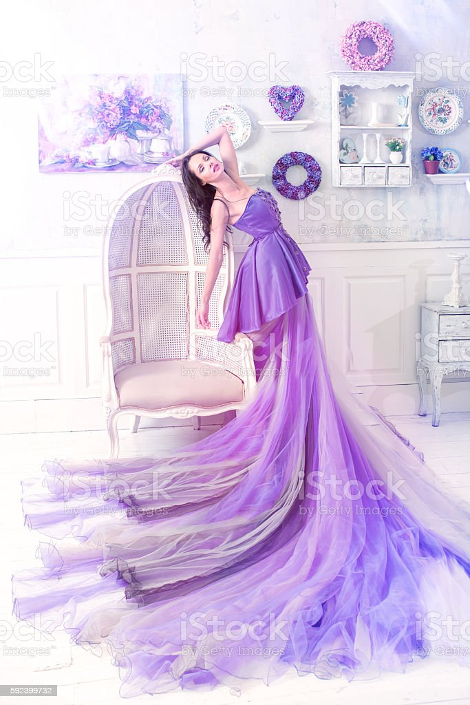 woman wearing long purple dress stock photo