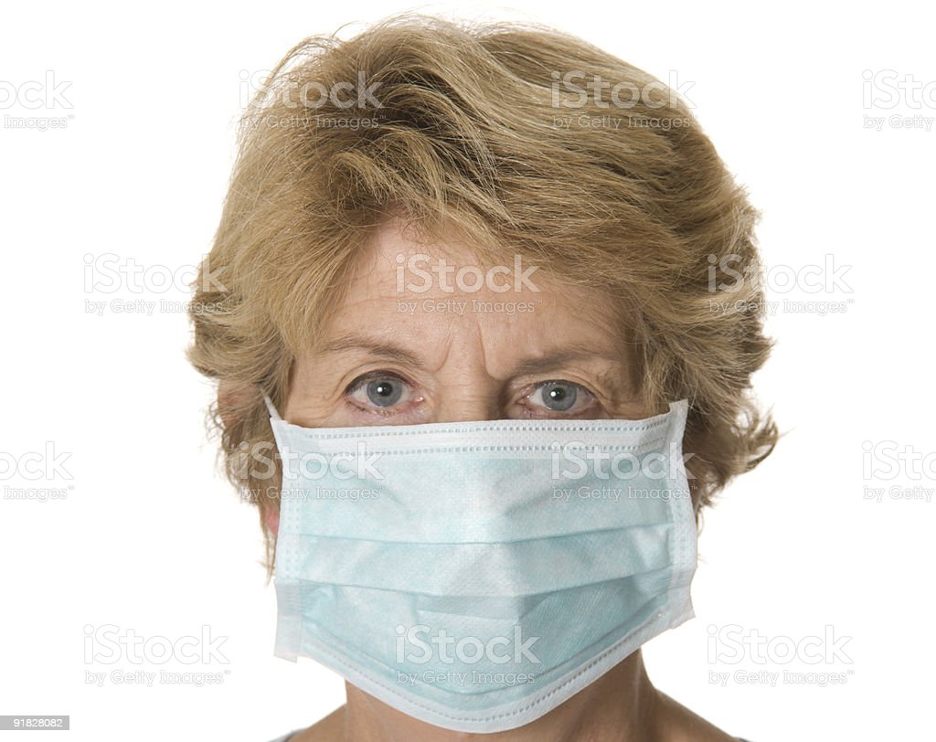 Woman wearing medical face mask royalty-free stock photo