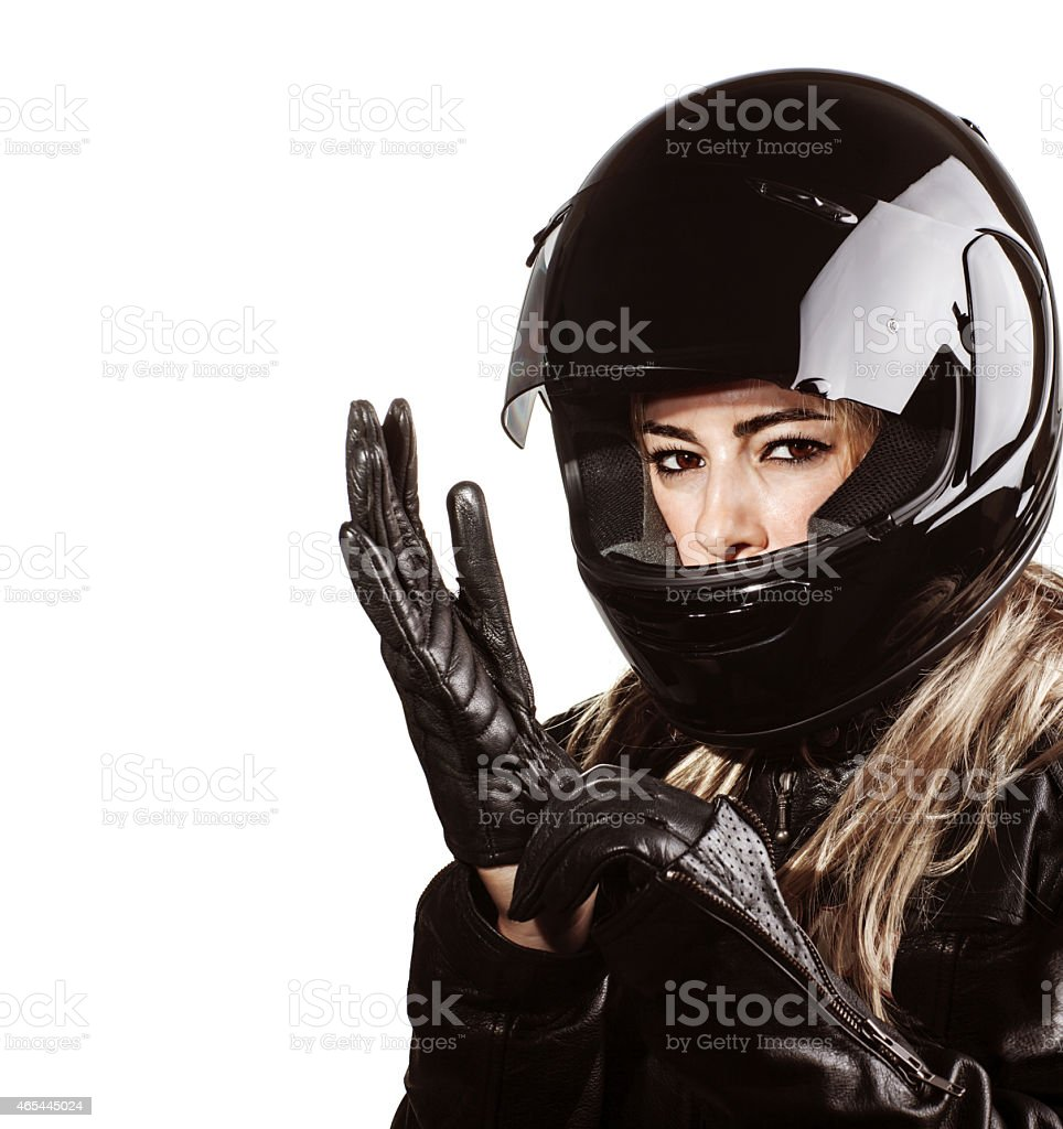 Woman wearing motorsport outfit stock photo