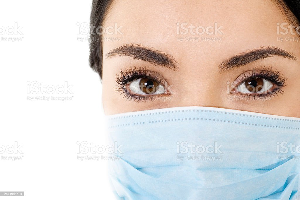 Woman wearing mouth cover mask stock photo