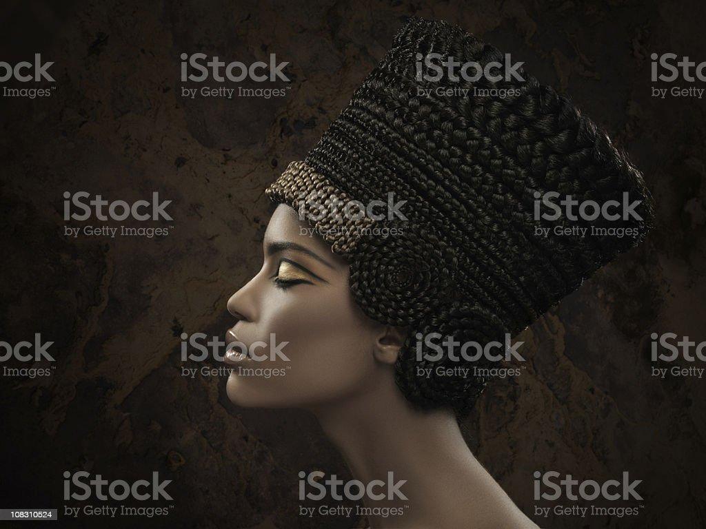 woman wearing Nefertiti crown stock photo
