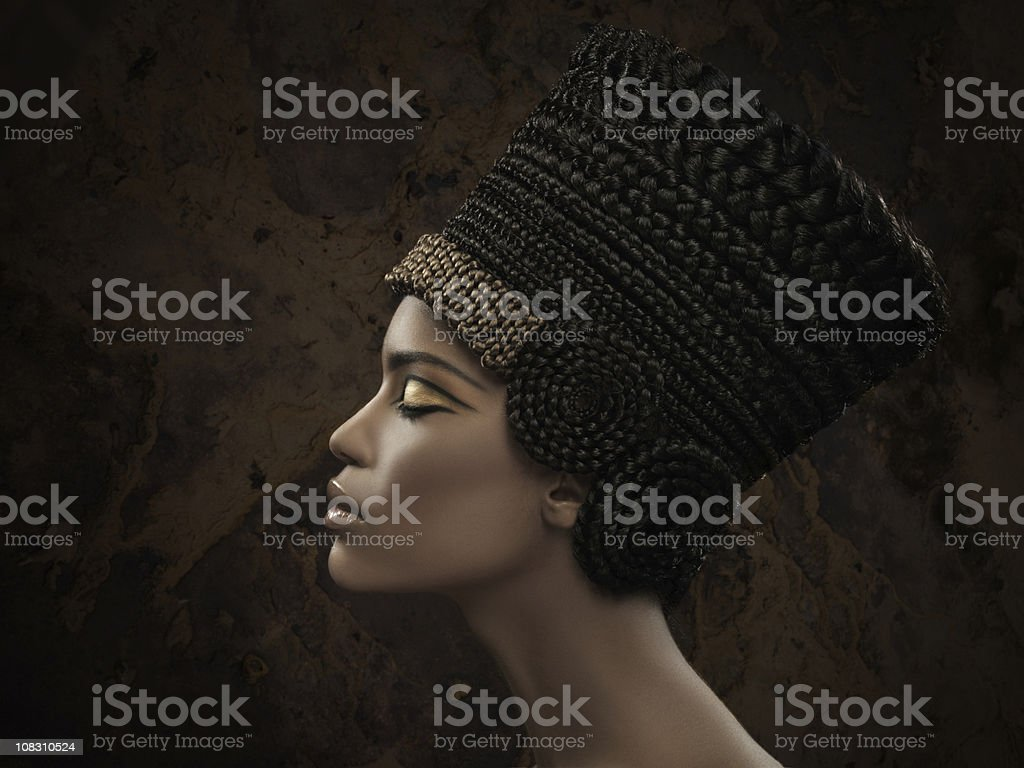 woman wearing Nefertiti crown stock photo
