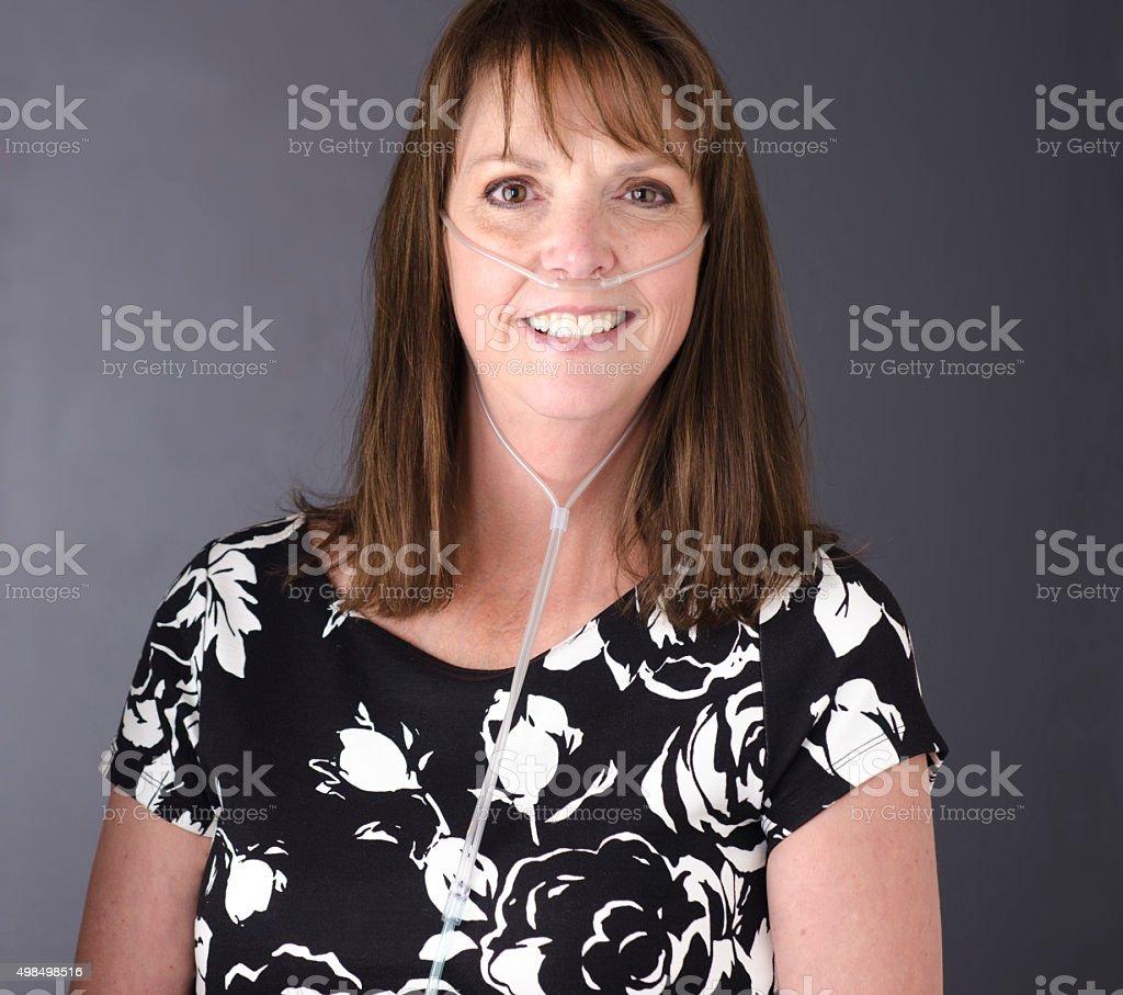 woman wearing oxygen tube stock photo