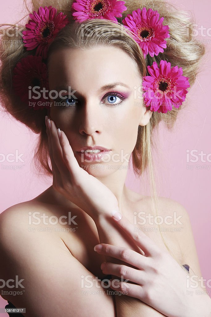 Woman Wearing Pink Flowers in Hair stock photo