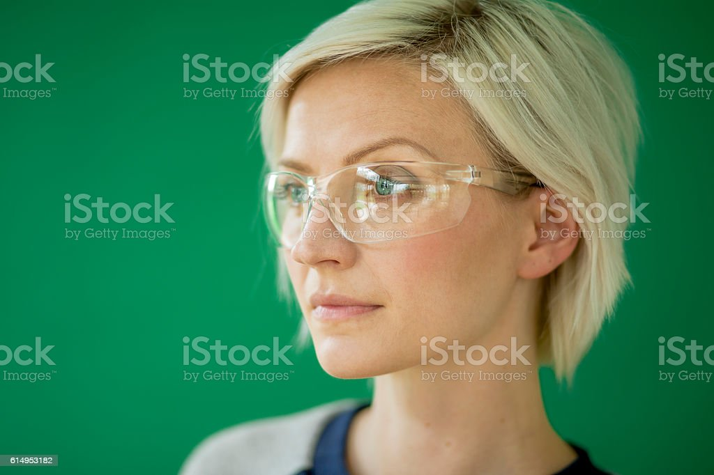 Woman Wearing Protective Glasses stock photo