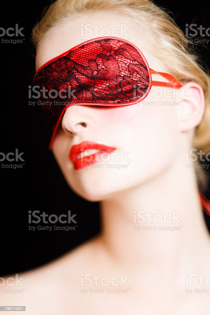Woman Wearing Red Lace Blindfold royalty-free stock photo