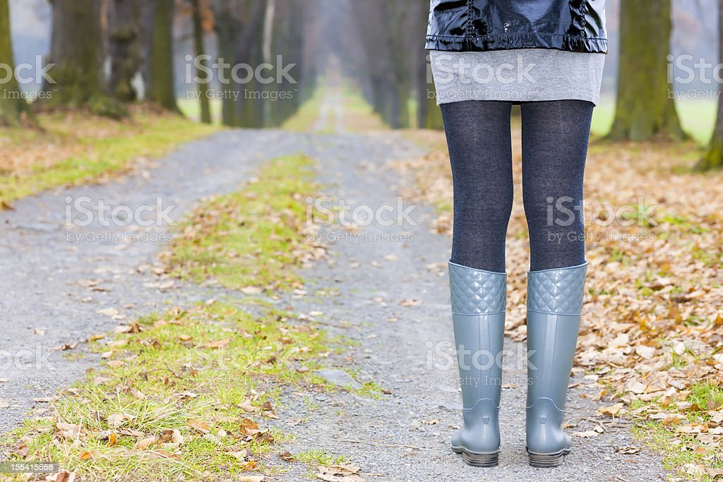 woman wearing rubber boots royalty-free stock photo