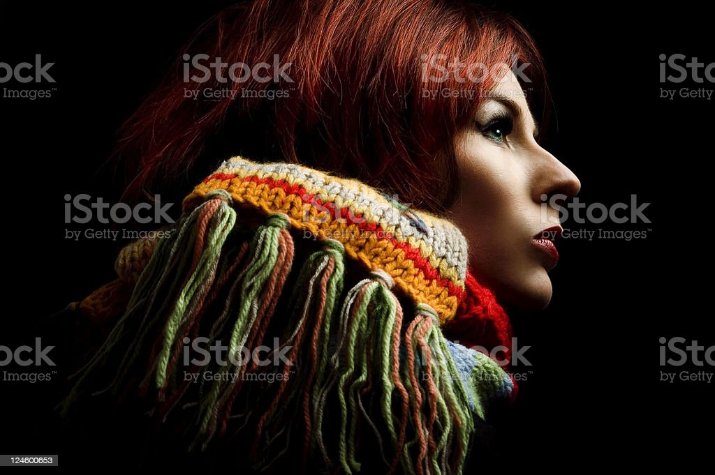 Woman Wearing Scarf on Black Background stock photo