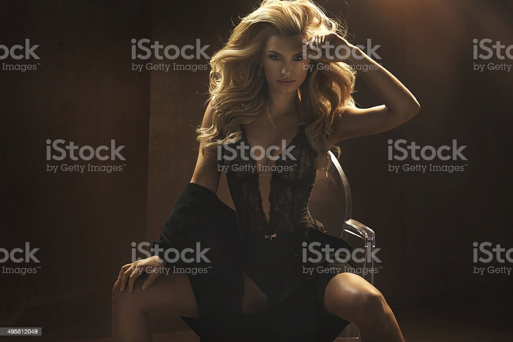 Woman wearing sexy black lingerie stock photo