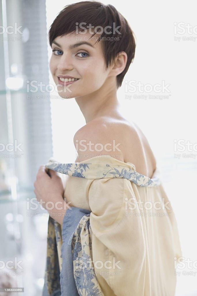 Woman wearing sheer robe in bathroom stock photo