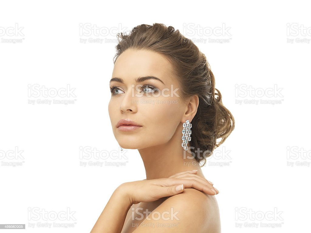 woman wearing shiny diamond earrings royalty-free stock photo