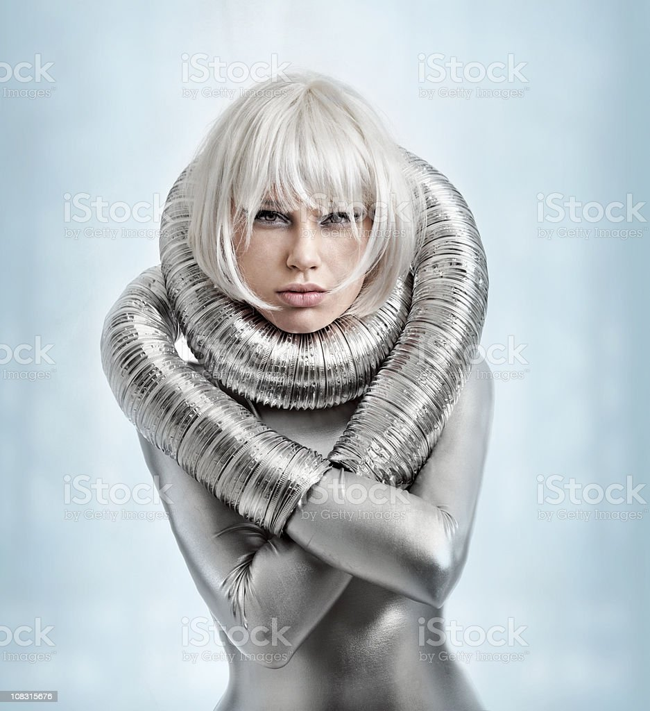 Woman wearing silver catsuit stock photo