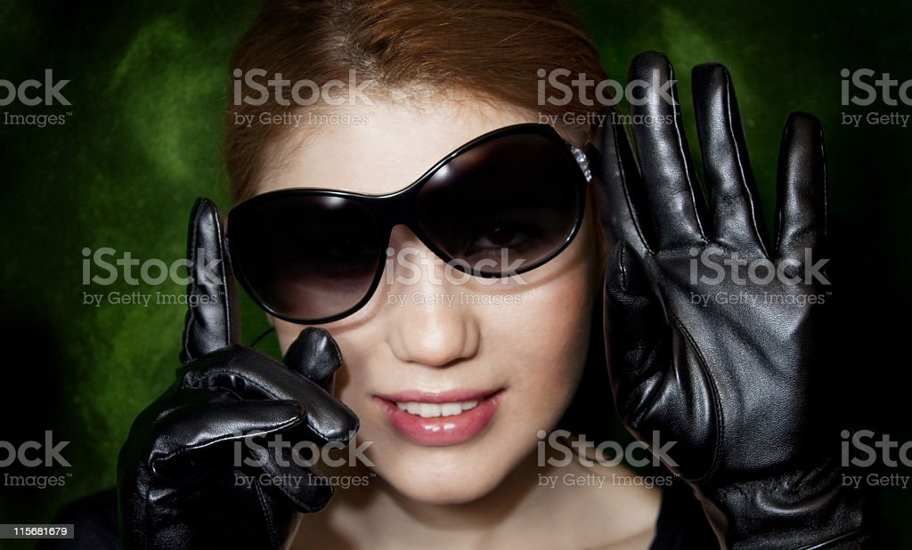 woman wearing sunglasses and gloves royalty-free stock photo