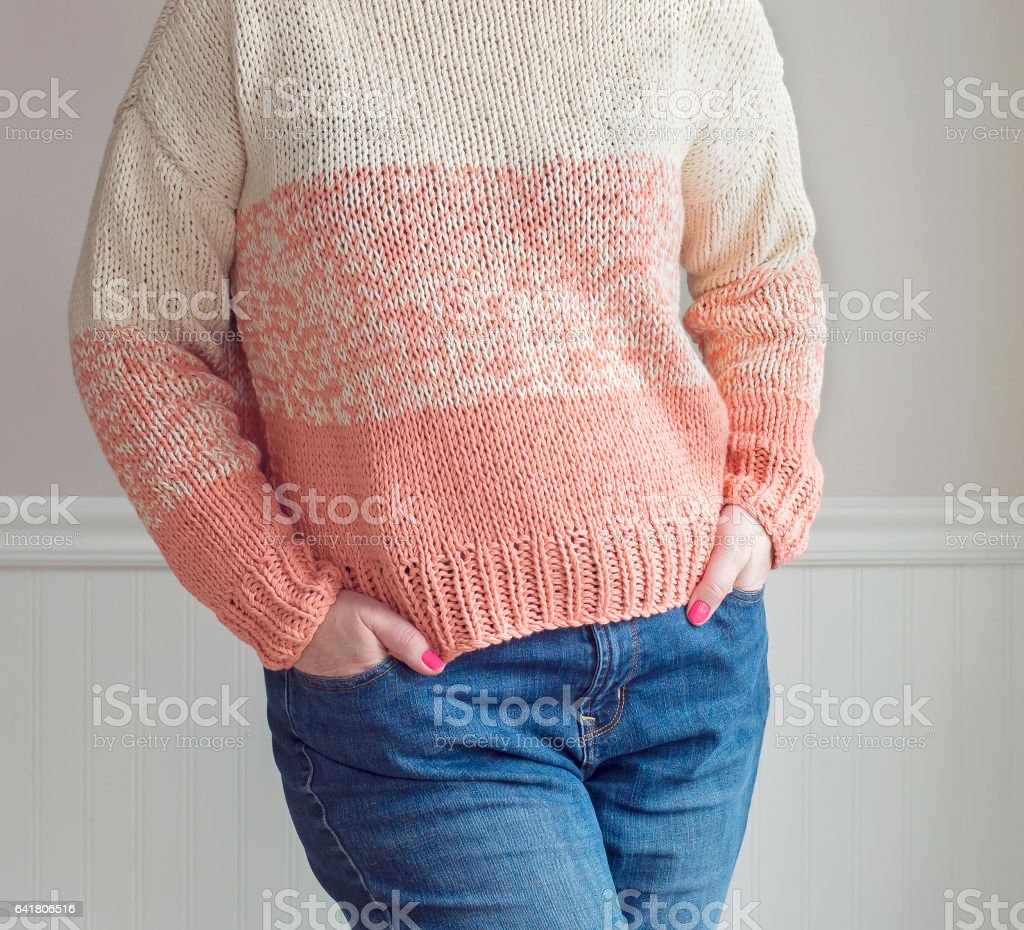 Woman wearing sweater and jeans stock photo