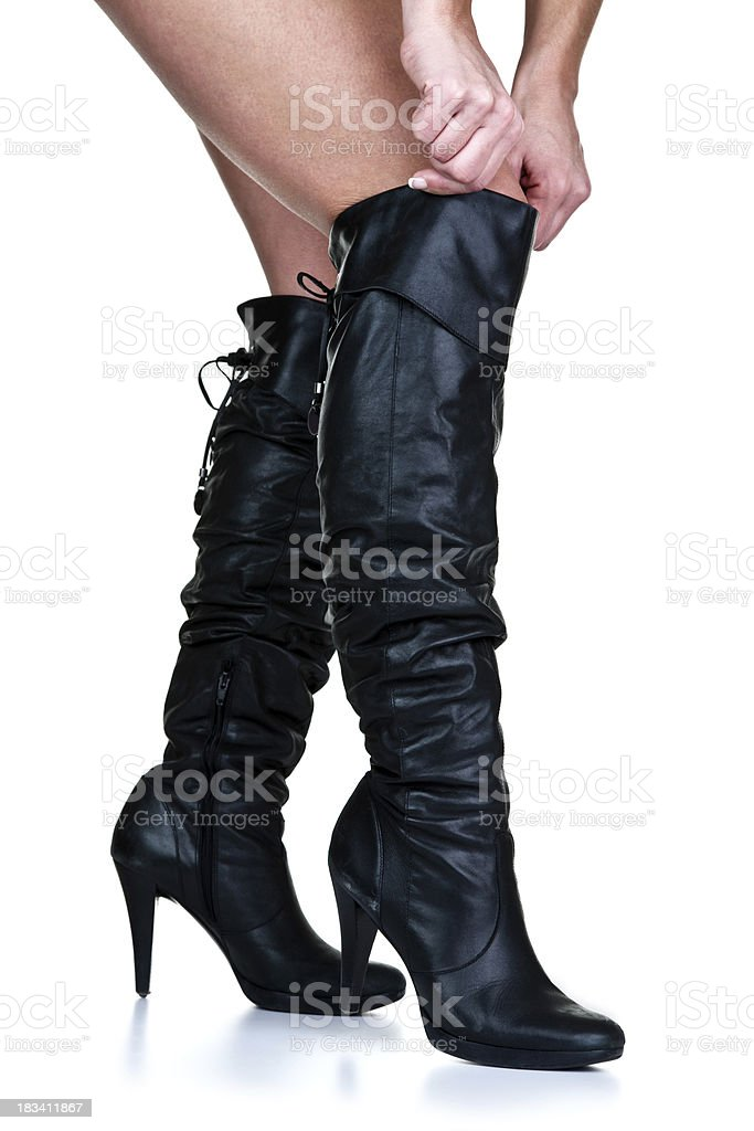 Woman wearing thigh high boots stock photo