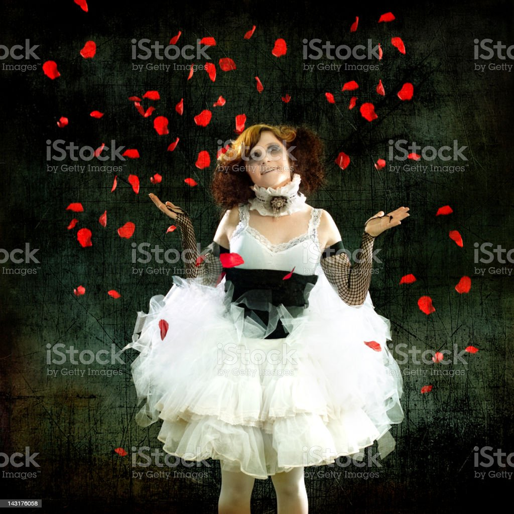 Woman Wearing Tutu with Falling Rose Petals stock photo