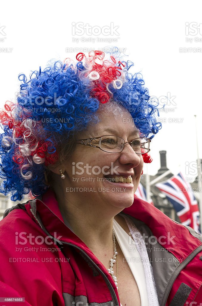 Woman wearing Union Jack wig waits for Royal Wedding, London royalty-free stock photo