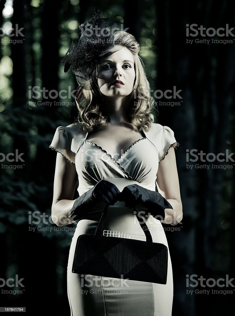woman wearing vintage clothes in a dark forest royalty-free stock photo