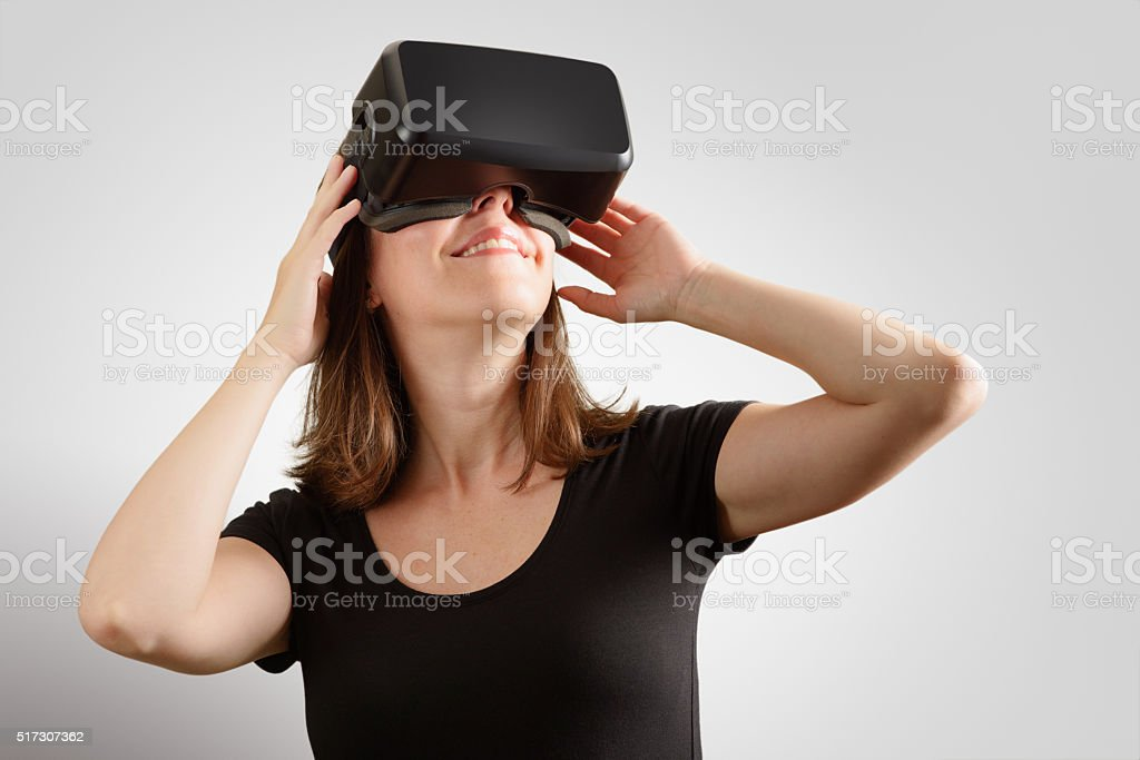 Woman Wearing Virtual Reality Headset stock photo