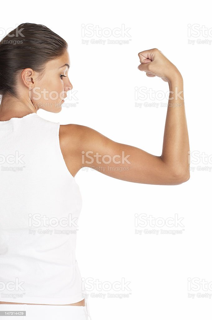A woman wearing white flexing her arm royalty-free stock photo