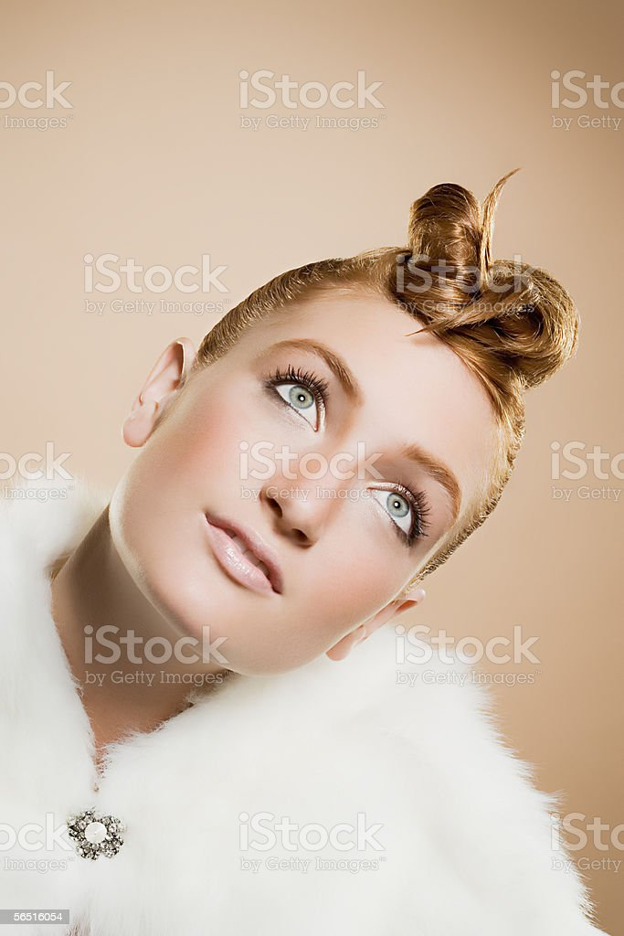 Woman wearing white fur and a brooch royalty-free stock photo
