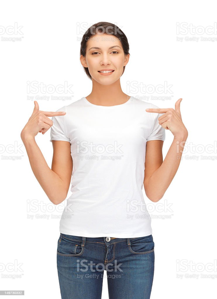 Woman wearing white top and jeans pointing at herself stock photo