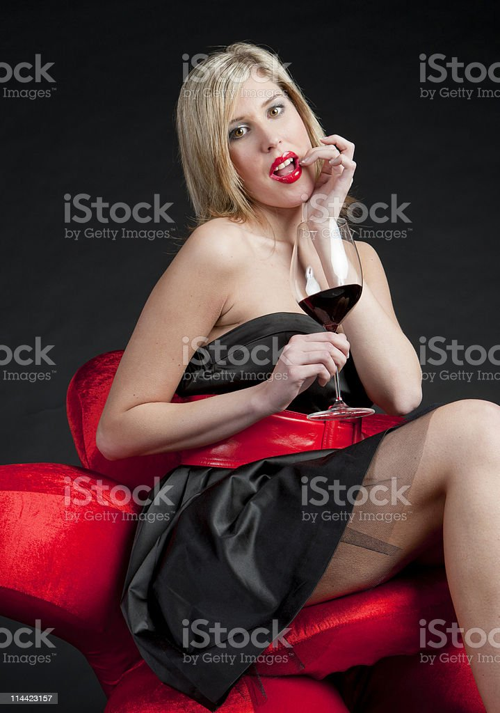 woman wearing with a glass of red stock photo