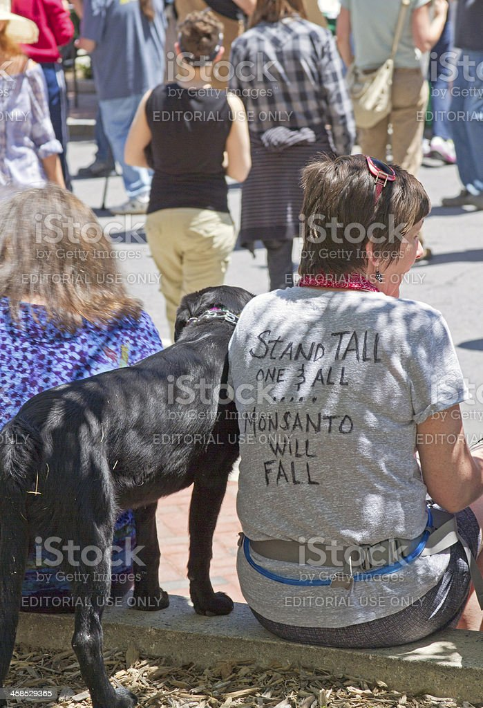 Woman Wears Anti-Monsanto T-shirt at a GMO Protest Rally royalty-free stock photo