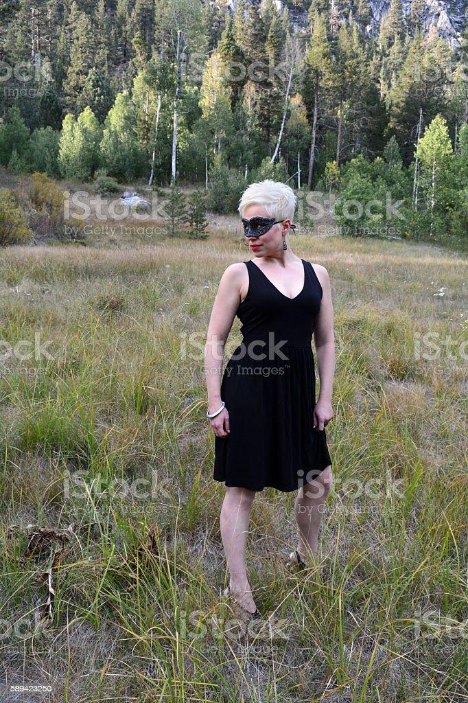 Woman Wears Black Eye Mask and Black Dress royalty-free stock photo