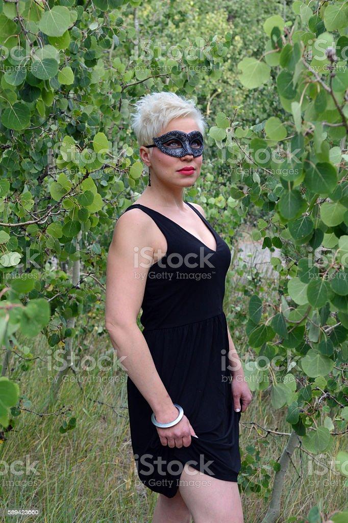 Woman Wears Black Eye Mask in Aspen Grove royalty-free stock photo