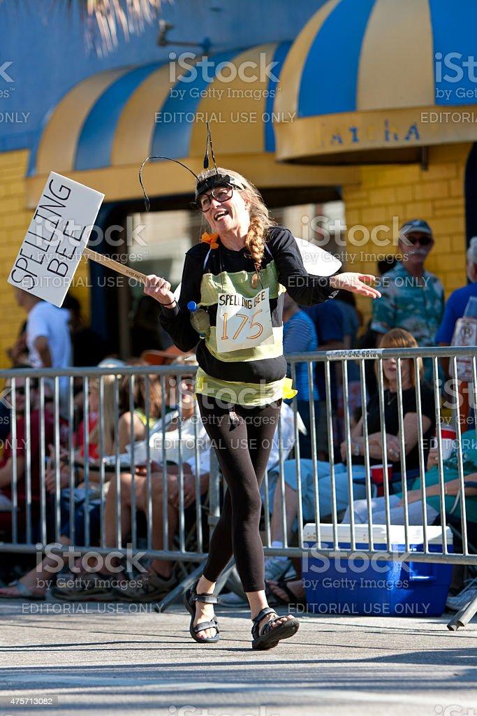 Woman Wears Spelling Bee Costume In Miami Mango Strut Parade stock photo