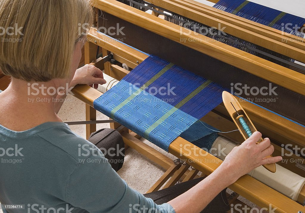 Woman Weaving on a Loom stock photo