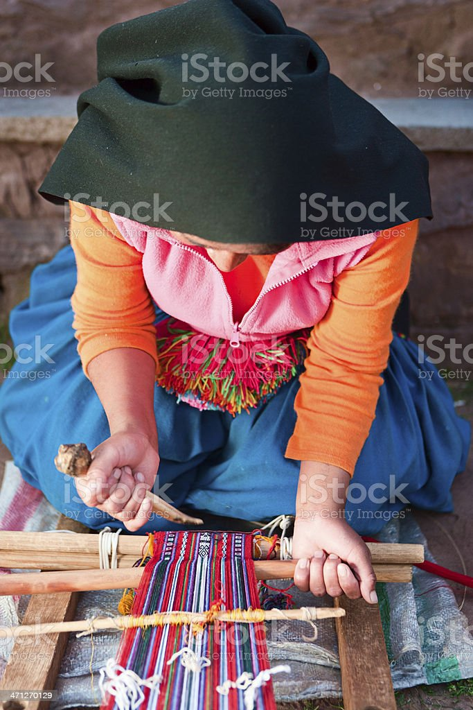 Woman weaving on Taquile Island in Peru royalty-free stock photo