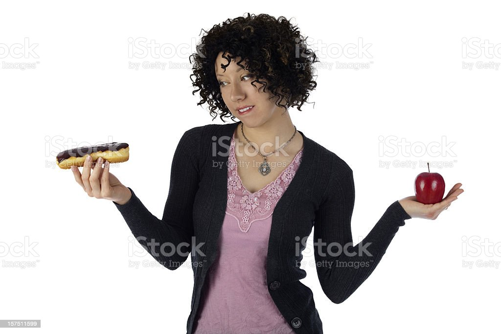 Woman Weighing Healthy Eating Choices;Diet Cravings Apple VS Donut royalty-free stock photo
