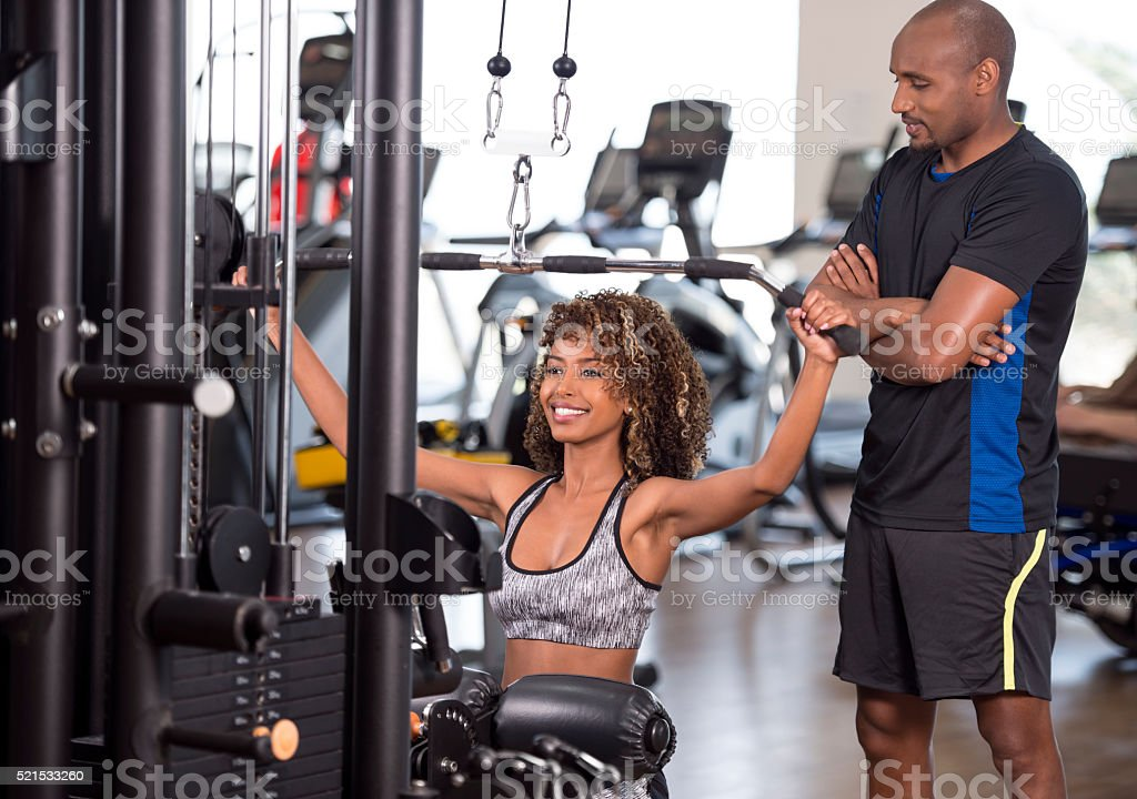 Woman weight training at health club. stock photo