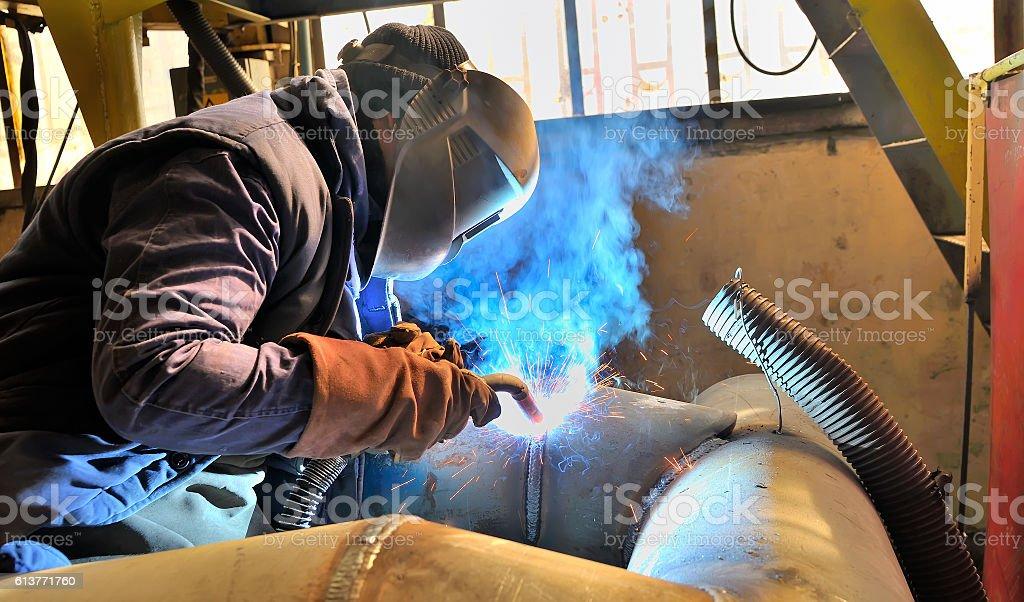 woman welder welding stock photo