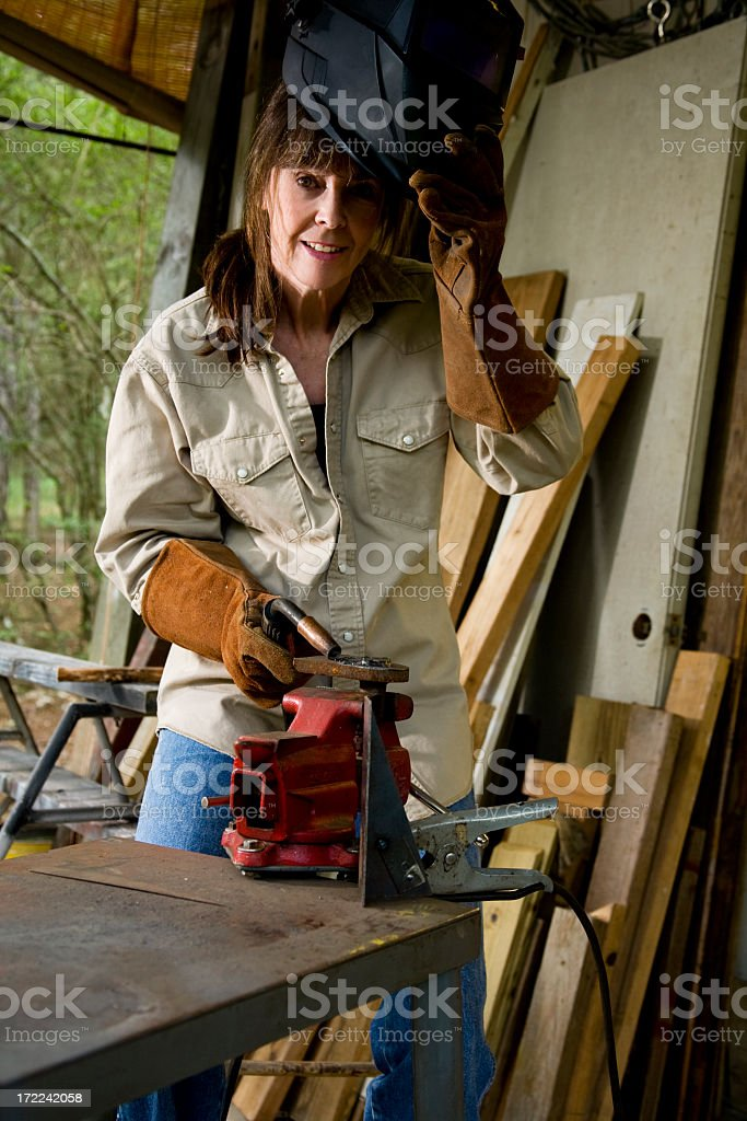 Woman welding. Female welder. Blue collar. Construction worker. stock photo