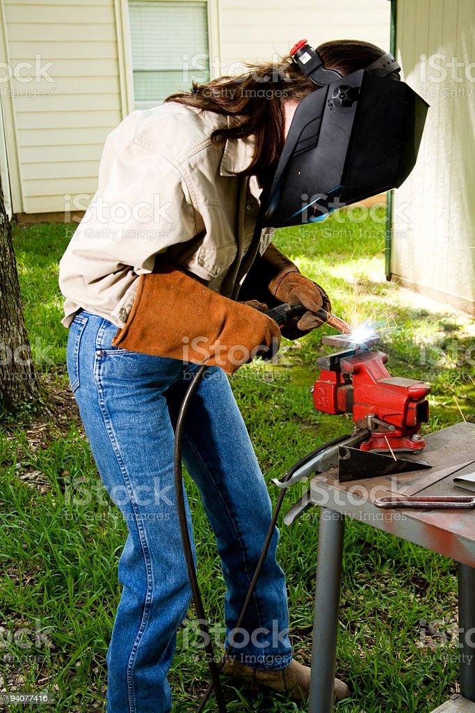 Woman welding stock photo