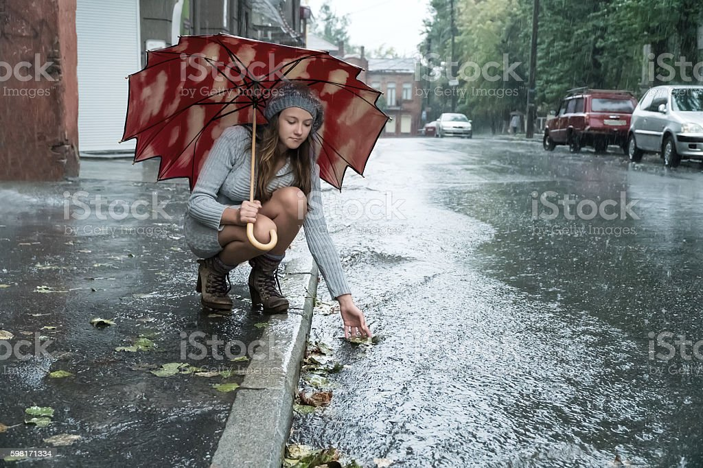 Woman wets his hand in the stream stock photo