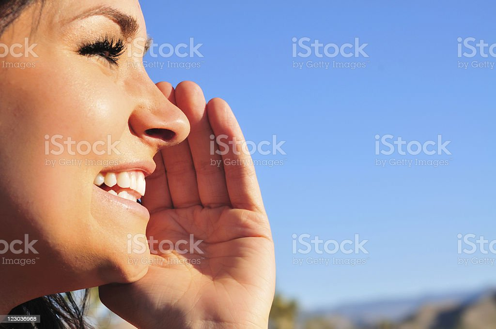 Woman Whispering a secret. royalty-free stock photo