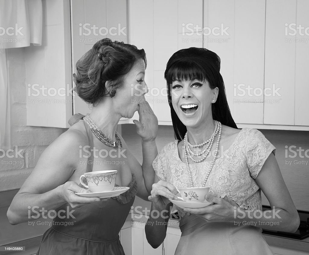 Woman Whispers Joke stock photo