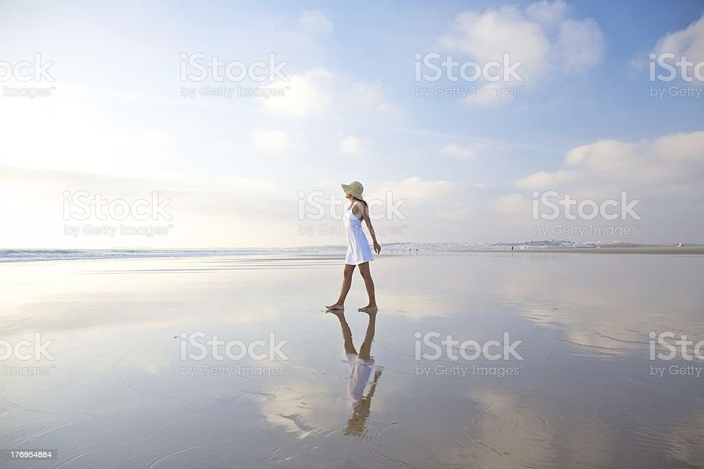 woman white dress and hat reflected on ocean sea beach royalty-free stock photo