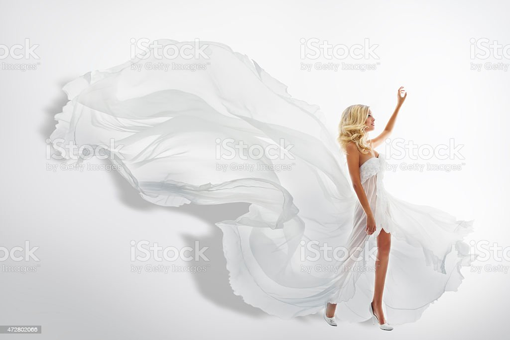 Woman White Waving Dress, Showing Hand Up, Flying Silk Fabric stock photo