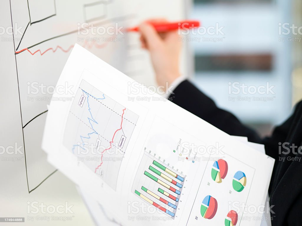 Woman who copies data into a white board royalty-free stock photo