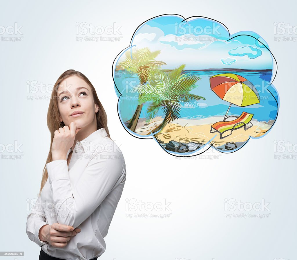 woman who dreams about summer vacation on the beach stock photo