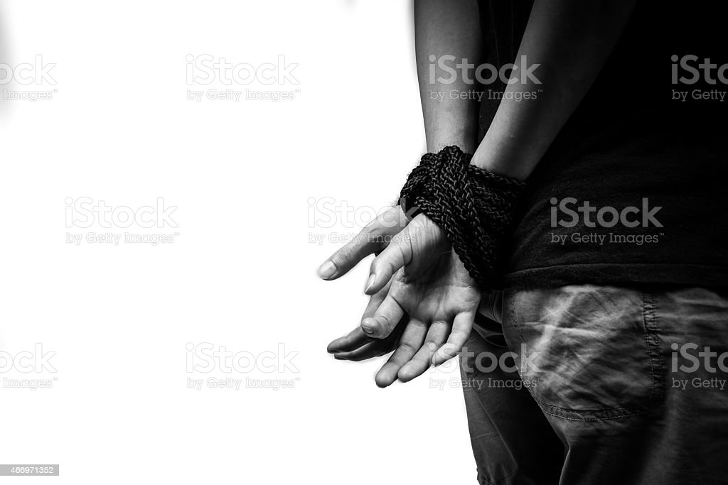 A woman who has been captured and bound up by her hands  stock photo