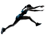 A woman who is jumping to start running