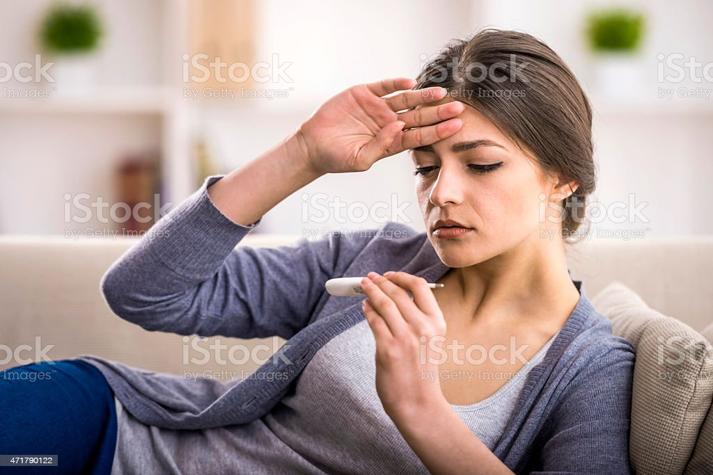 A woman who is worried that she might have a disease  stock photo