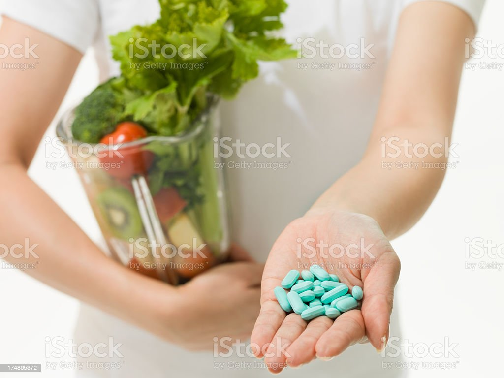 Woman who presents medicine while it has a juicer royalty-free stock photo