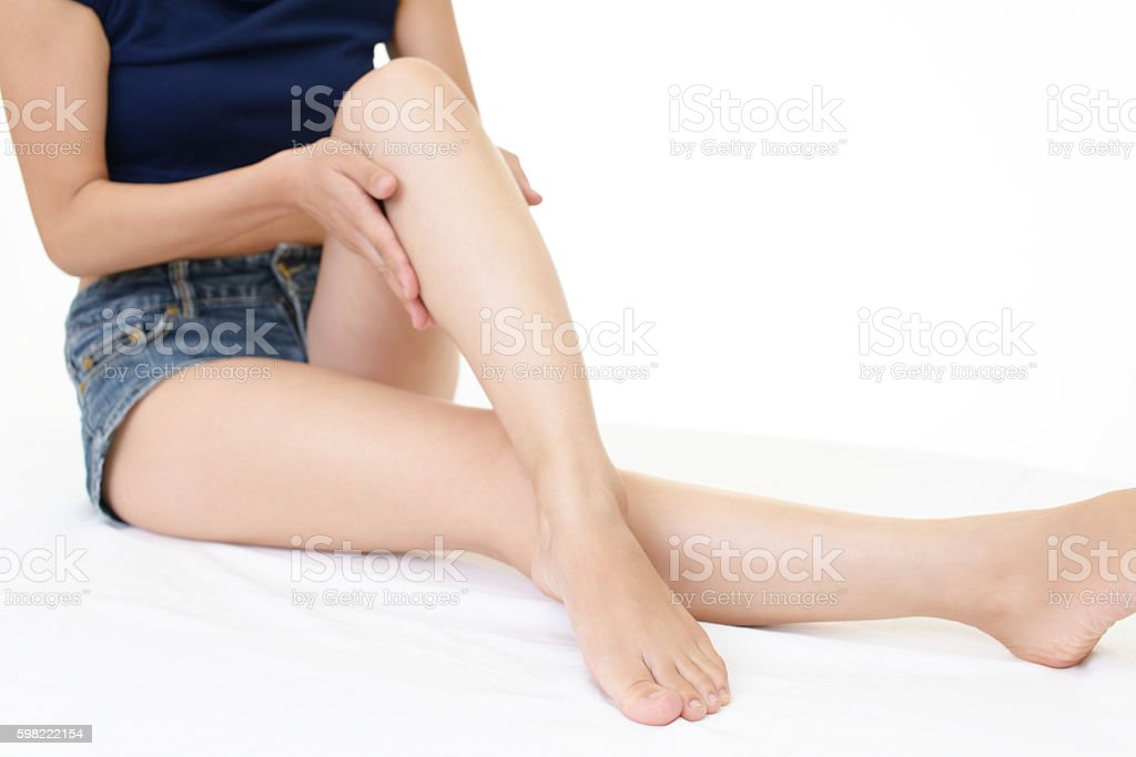 Woman who takes care of her legs stock photo